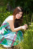 Asian beauty outdoor. Young asian woman basking in the sunlight outdoors Stock Photos