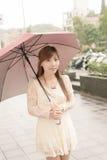 Asian beauty in raining day Royalty Free Stock Photos