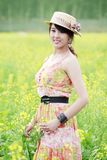 Asian beauty in rape field Royalty Free Stock Photo