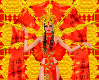Asian beauty with red and gold fantasy outfit and background. Royalty Free Stock Image