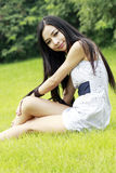 Asian beauty relaxing outdoors Royalty Free Stock Photography