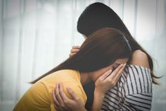 Asian beauty sad girl was comforted by a girl friend. People and royalty free stock photos