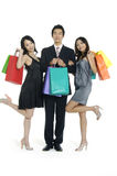 Asian beauty shopping. Photo of three happy friends with shopping bags on the background Royalty Free Stock Photos