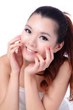 Asian beauty skin care woman smiling close-up. Beautiful young woman touching her face looking to the side. Isolated on white background Royalty Free Stock Images