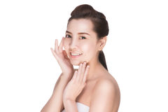 Asian beauty skincare woman touching skin on face Stock Photos