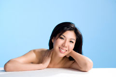Asian beauty with smile. Clean and refreshing smiling face of an asian young woman Royalty Free Stock Photography