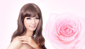 Asian beauty smile face with pink rose Stock Images