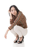Asian beauty squat and feel boring Royalty Free Stock Photo