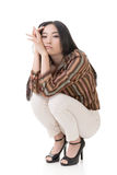 Asian beauty squat and feel boring Stock Image