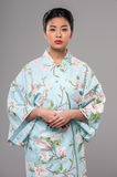Asian beauty in traditional clothes Royalty Free Stock Photo