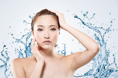Asian beauty with water Stock Photos