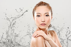 Asian beauty with water Royalty Free Stock Photo