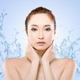 Asian beauty with water Stock Images