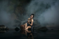Asian beauty woman taking bath in a stream Royalty Free Stock Photos