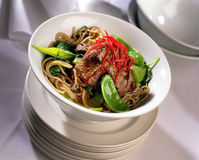 Asian Beef. Main course restaurant meal of Beef with Noodles Royalty Free Stock Photos