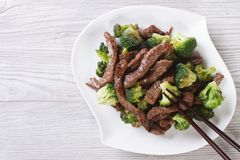 Asian beef with broccoli and chopsticks. horizontal top view Stock Photos