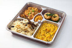 Asian Bento. Five dishes Indian Bento on a disposable silverware Stock Photo