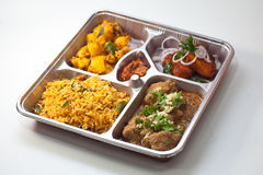 Asian Bento. Five dishes Indian Bento on a disposable silverware Stock Photography