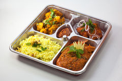 Asian Bento. Five dishes Indian Bento on a disposable silverware Stock Image