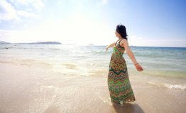 Asian beutiful girl walking on the beach Stock Photos