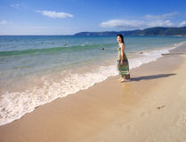 Asian beutiful girl walking on the beach Stock Photo
