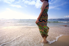 Asian beutiful girl walking on the beach Royalty Free Stock Photo