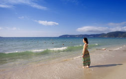 Asian beutiful girl walking on the beach Royalty Free Stock Photography