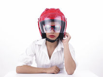 Asian biker girl wearing a helmet. A sexy asian biker female wearing a red helmet Stock Image