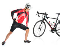Asian biker warming up. Or cool down, standing beside bike, isolated on white background Royalty Free Stock Photography