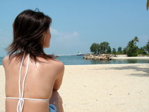 Asian bikini at beach. Relaxation at its best. Happy absorbing in the sun by the seaside Stock Images