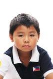 Asian Boy looks grumpy Stock Images