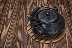Asian black traditional teapot for tea ceremony Royalty Free Stock Images