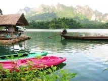 Asian boat VS Canoe boat Stock Photos