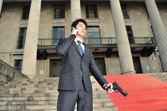 Asian Body Guard listening for instructions Stock Photography