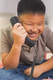 Asian bouy looks so happy on the phone Stock Photography