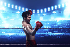 Asian boxer guy expression with boxing gloves Stock Photo