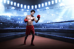 Asian boxer guy training uppercut before the game Royalty Free Stock Photo