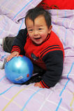 Asian Boy. Play is every child's nature Royalty Free Stock Image