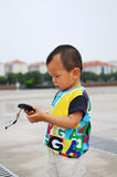 Asian Boy. Play is every child's nature Royalty Free Stock Photography