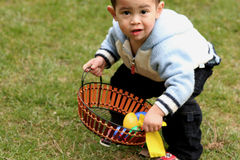 Asian boy. Holding  easter basket Stock Photo