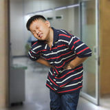 Asian boy with an abdominal pain Stock Photos