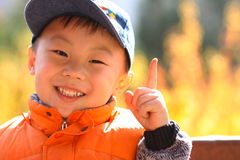 Asian boy act as victory Royalty Free Stock Photo