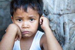 Asian boy against wall portrait Royalty Free Stock Photos