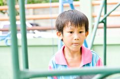 Asian boy attend playing outdoor Royalty Free Stock Photo
