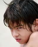 Asian Boy with an attitude. Portait of a 10 years old asian boy challenging you with his look Royalty Free Stock Photo