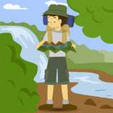 Asian boy with backpack. Studying map Royalty Free Stock Images