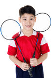 Asian boy in badminton action Stock Photo