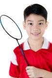 Asian boy in badminton action Stock Image