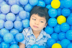 Asian Boy in a Ball pool Royalty Free Stock Images