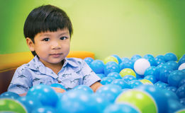 Asian boy in ball pool Royalty Free Stock Photography
